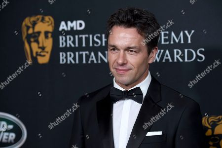 Julian Ovenden arrives at the BAFTA Los Angeles Britannia Awards at the Beverly Hilton Hotel, in Beverly Hills, Calif