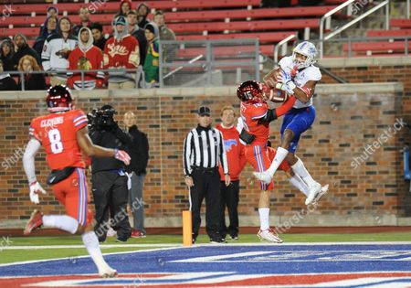 Southern Methodist Mustangs defensive back Jordan Wyatt (15) breaks up a pass intended for Tulsa Golden Hurricane wide receiver Josh Stewart (1) during the 1st half of the NCAA Football game between the Tulsa Golden Hurricane at Southern Methodist Mustangs at Gerald J. Ford Stadium in Dallas, Texas