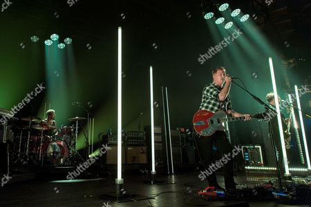 Queens Of The Stone Age - Jon Theodore, Josh Homme and Michael Shuman
