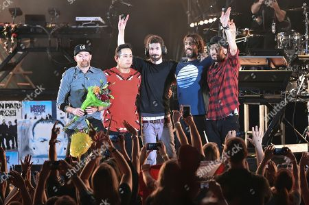 Stock Picture of Linkin Park members, Dave Farrell, Joe Hahn, Brad Delson, Rob Bourdon, Mike Shinoda. Dave Farrell, from left, Joe Hahn, Brad Delson, Rob Bourdon and Mike Shinoda of Linkin Park at the end of Linkin Park and Friends Celebrate Life in Honor of Chester Bennington at the Hollywood Bowl, in Los Angeles