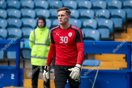 First team debutant Barnsley goalkeeper Jack Walton (30) warming up during the EFL Sky Bet Championship match between Sheffield Wednesday and Barnsley at Hillsborough, Sheffield