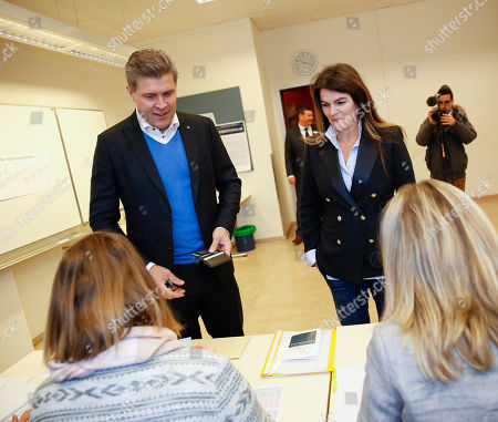 Stock Image of Bjarni Benediktsson, Prime Minister of Iceland, and leader of the Independence Party and his wife Thora Margret Baldvinsdottir cast their ballots during the general election in Gardabaer, Iceland, . Icelanders are voting for the third time in four years as the nation tries to shake off the latest political crisis on an island that has been roiled by divisions since its economy was ravaged by the global financial crisis in 2008
