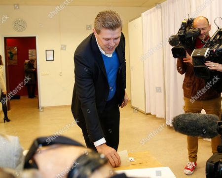 Bjarni Benediktsson, Prime Minister of Iceland, and leader of the Independence Party casts his vote during the general election in Gardabaer, Iceland, . Icelanders are voting for the third time in four years as the nation tries to shake off the latest political crisis on an island that has been roiled by divisions since its economy was ravaged by the global financial crisis in 2008