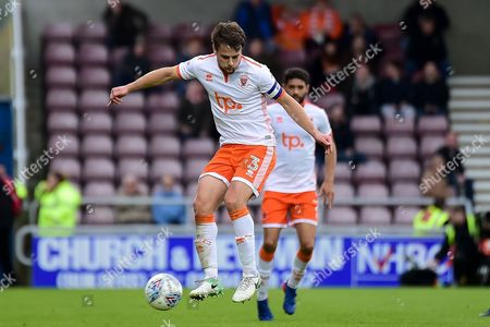 Blackpool defender Andy Taylor (3) controls the ball during the EFL Sky Bet League 1 match between Northampton Town and Blackpool at Sixfields Stadium, Northampton