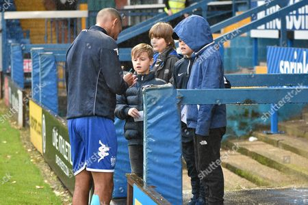 Bury Forward, Jermaine Beckford (9) sign autographs for young fans during the EFL Sky Bet League 1 match between Bury and Doncaster Rovers at the JD Stadium, Bury
