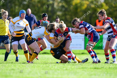 Claire Molloy of Bristol Ladies  is tackled by Amy Cokayne of Wasps Ladies