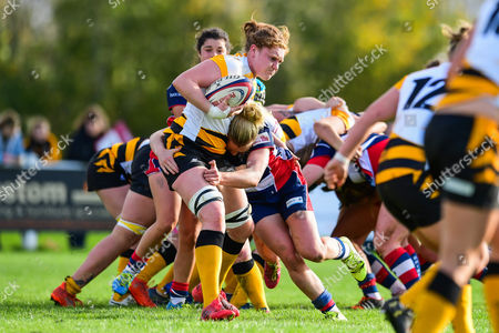 Stock Picture of Harriet Millar-Jones of Wasps Ladiesis tackled by Claire Molloy of Bristol Ladies
