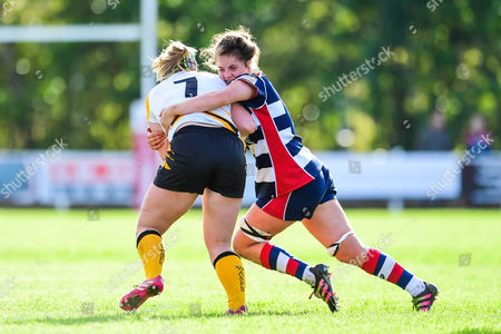 Amy Cokayne of Wasps Ladies is tackled by Poppy Leitch of Bristol Ladies