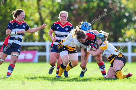 Amelia Buckland-Hurry of Bristol Ladies is tackled by Amy Cokayne of Wasps Ladies
