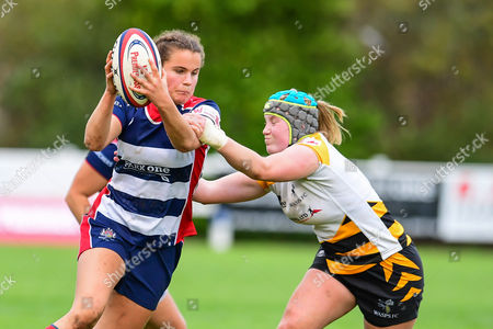 Lucy Attwood of Bristol Ladies is tackled by Amy Cokayne of Wasps Ladies