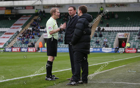 Referee Gavin Ward has a word with Plymouth Argyle's manager Derek Adams watched by Fourth Official Ben Cobb during the Sky Bet League 1 match between Plymouth Argyle and Rochdale on Saturday 28th October 2017 at Home Park, Plymouth, Devon