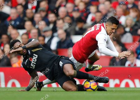 Arsenal's Alexis Sanchez, right, and Swansea's Leroy Fer challenge during the English Premier League soccer match between Arsenal and Swansea City at the Emirates stadium in London