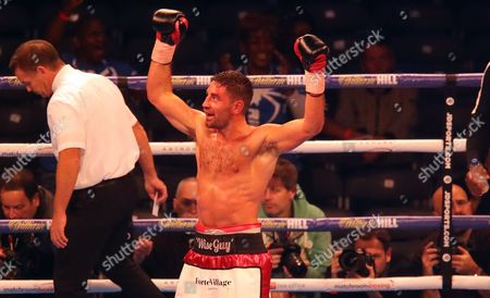 Frank Buglioni celebrates victory over Craig Richards to defend his British Light-Heavyweight Championship
