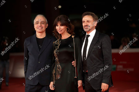 """From left Director Pablo Berger, actress Maribel Verdu and actor Jose Mota, pose on the red carpet on the occasion of the screening of the movie """"Abracadabra"""", at the 12th edition of the Rome Film Fest, in Rome"""
