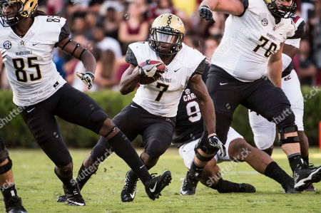 Ralph Webb, Chris Pierce, Egidio DellaRipa. Vanderbilt running back Ralph Webb (7) runs between Chris Pierce (85) and Egidio DellaRipa (76) during the first half of an NCAA college football game against South Carolina, in Columbia, S.C