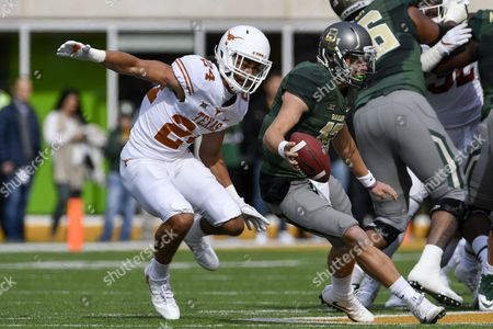 Baylor Bears quarterback Charlie Brewer (12) tries to escape Texas Longhorns defensive back John Bonney (24) during an NCAA football game between the Texas Longhorns and the Baylor Bears at McLane Stadium in Waco, Texas