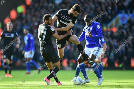 Aston Villa midfielder Mile Jedinak (15) and Aston Villa defender Ahmed Elmohamady (27) battle for potion with Birmingham City midfielder Cheikh N'Doye (17) during the EFL Sky Bet Championship match between Birmingham City and Aston Villa at St Andrews, Birmingham