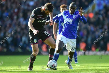 Birmingham City midfielder Cheikh N'Doye (17) battles for possession with Aston Villa midfielder Mile Jedinak (15) during the EFL Sky Bet Championship match between Birmingham City and Aston Villa at St Andrews, Birmingham
