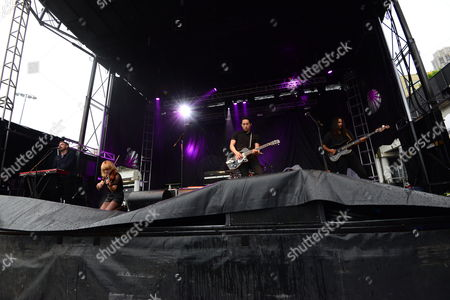 Stock Picture of Mikel Jollett, Noah Harmon, Anna Bulbrook, and Steven Chen with The Airborne Toxic Event performing at the Shaky Knees Music Festival, in Atlanta