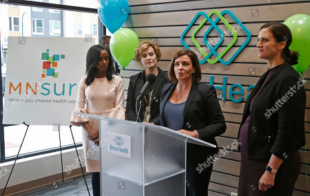 Stock Image of Allison O'Toole, Hodan Guled, Betsy Hodges, Emily Piper. Allison O'Toole, second from right, speaks to the media at the new offices of Briva Health, MNsure's largest enrollment partner, in Minneapolis. Health care consumers in most of the country are encountering a world of confusion and chaos as the open enrollment period to sign up for coverage approaches. The outlook is decidedly different in the 12 states that operate their own marketplaces. California, Colorado, Minnesota and other states that operate autonomous exchanges are pulling out all the stops to inform consumers. Also shown, from left, Hodan Guled, chief executive officer of Briva Health, Minneapolis Major Betsy Hodges and at right, Emily Piper, commissioner of Minnesota Human Services
