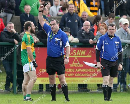 Clonmel Commercials vs Dr. Crokes. Clonmel?s Jamie Peters is shown a black card by Referee Kevin Murphy