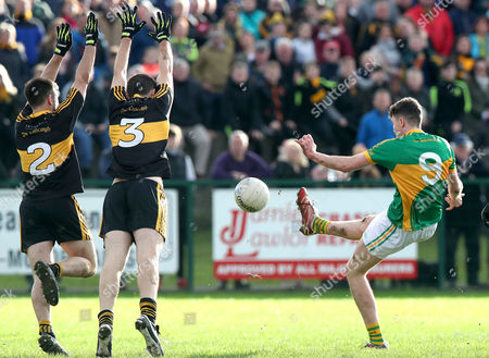 Clonmel Commercials vs Dr. Crokes. ClonmelÕs Jack Kennedy has a ball blocked by John Payne with Michael Moloney of Dr Crokes