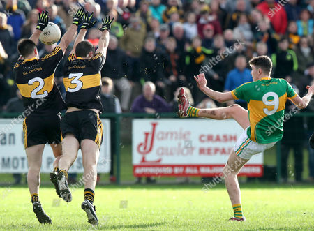 Clonmel Commercials vs Dr. Crokes. Clonmel?s Jack Kennedy has a ball blocked by John Payne with Michael Moloney of Dr Crokes