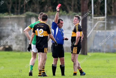 Clonmel Commercials vs Dr. Crokes. Dr Crokes Alan O'Sullivan is shown a red card by Referee Kevin Murphy