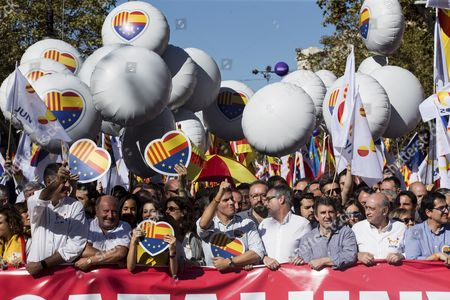 """Leader of PP party in Catalonia Xavier Garcia Albiol (L), President of Ciudadanos party Albert Rivera (C), leader of Ciudadanos in Catalonia, Ines Arrimadas (3-L), and former minister of Home Affairs Jorge Fernandez Diaz (2-R) take part in a protest called by the Societat Civil Catalana (lit: Catalan Civil Society) under the slogan 'We all are Catalonia"""" against the unilateral declaration of independence (UDI) proclaimed on 27 October by the Catalan Parliament, in Barcelona, northeastern Spain, on 29 October 2017."""
