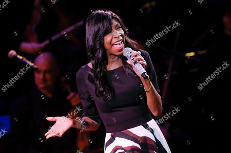 """Singer Natalie Cole performs at """"An Evening of SeriousFun Celebrating the Legacy of Paul Newman"""" in New York. The sister of Natalie Cole said she was disappointed by the Recording Academy's tribute to the late singer during Monday's 58th annual Grammy Awards. The telecast featured a clip from the 1992 Grammys performance of Natalie Cole singing in sync with her father, Nat King Cole, who appeared in video, at the conclusion of the In Memoriam tribute to musicians and artists who died in the previous year"""