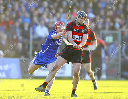 Ballygunner vs Thurles Sarsfields. Pauric Mahony of Ballygunner shoots under pressure from Billy McCarthy of Thurles Sarsfields