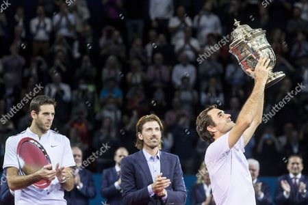 Juan Martin del Potro, Fabian Cancellara and Roger Federer, from left, during the award ceremony after the final between Switzerland's Roger Federer and Argentina's Juan Martin del Potro at the Swiss Indoors tennis tournament at the St. Jakobshalle in Basel, Switzerland, on Sunday, October 29, 2017.