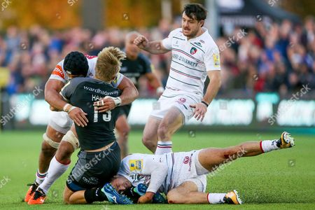 Leicester Tigers Number 8 Sione Kalamafoni (8) hits Newcastle Falcons Centre Chris Harris (13) with Leicester Tigers Wing Jonny May (11) holding on in the tackle during the Aviva Premiership match between Newcastle Falcons and Leicester Tigers at Kingston Park, Newcastle