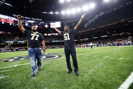 Carl Nicks, Jonathan Vilma. Former New Orleans Saints players Carl Nicks (77) and Jonathan Vilma (51) cheer on the crowd for the Saints cheer before an NFL football game in New Orleans