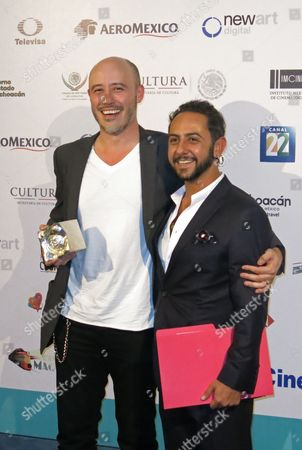 "Stock Photo of Mexican Director Marcelo Tobar, left, and Mexican actor Humberto Busto pose with the award for Best Mexican Film, for ""Oso Polar,"" at the Morelia Film Festival in Morelia, Mexico. The film was shot entirely with cellphones"