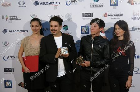 """Stock Image of The cast and crew of the Mexican film """"Ayer maravilla fui"""" pose with their awards for Best First or Second Film, and best actor for Sonia Franco, not in picture, at the Morelia Film Festival in Morelia, Mexico. From left to right are producer Gabriela Gavica, director Gabriel Marino Garza, actor Hoze Melendez and the actor Siouzana Melikian"""
