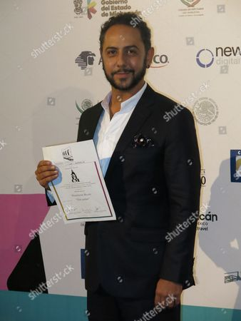 "Stock Image of Mexican actor Humberto Busto poses with a special mention for his role in the film ""Oso Polar"" at the Morelia Film Festival in Morelia, Mexico"