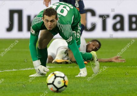 Zenit's goalkeeper Andrey Lunyov looks at the ball during a Russia's Premier League soccer match between Zenit St. Petersburg and Lokomotiv Moscow in St. Petersburg, Russia