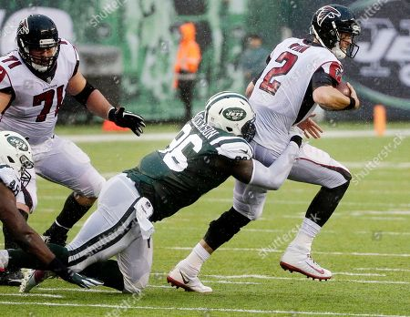 Muhammad Wilkerson, Matt Ryan. New York Jets defensive end Muhammad Wilkerson (96) sacks Atlanta Falcons quarterback Matt Ryan (2) during the first half of an NFL football game, in East Rutherford, N.J