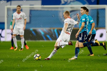 Vladislav Ignatyev of FC Lokomotiv and Daler Kuzyayev of FC Zenit in action.