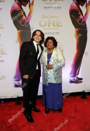 "Prince Jackson, left, and Katherine Jackson arrive at the world premiere of ""Michael Jackson ONE"" at THEhotel at Mandalay Bay Resort and Casino, in Las Vegas. A Los Angeles jury will have to considering how much to award Jackson's three children and mother if they determine that concert promoter AEG Live LLC hired the doctor convicted of causing the superstar's June 2009 death. Deliberations are expected to begin, after a 21 week trial that has revealed many of Michael Jackson's ambitions, including a new career in filmmaking"