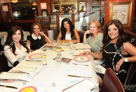 """This photo shows cast members from Bravo''s """"The Real Housewives of New Jersey"""", from left, Jacqueline Laurita, Melissa Gorga, Teresa Giudice, Caroline Manzo and Kathy Wakile at Bond 45 in New York. The popular reality show airs Sundays at 8 p.m. EST on Bravo"""