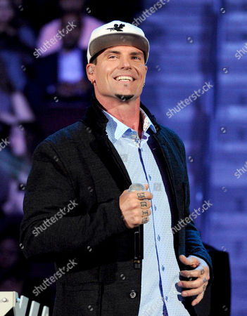 """Recording Artist Vanilla Ice appears at the 2013 Soul Train Awards at the Orleans Arena in Las Vegas. Police in the Palm Beach County town of Lantana, Fla., say the recording artist and home-improvement-show host has been charged with breaking into and stealing from an abandoned home that is in foreclosure. They said in a news release that some of the items stolen were found at his property. Vanilla Ice, whose real name is Robert Van Winkle, rose to fame following the 1990 release of the hit song """"Ice Ice Baby."""" In recent years, he has hosted """"The Vanilla Ice Project"""" on DIY Network"""