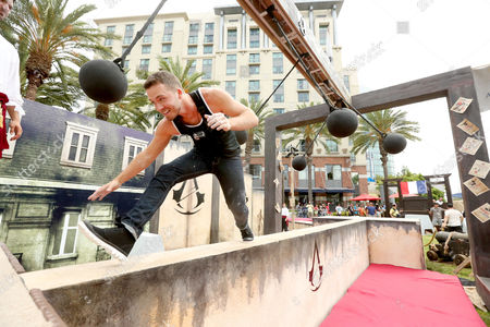 Stephen Lunsford runs the parkour course at Ubisoft's Assassin's Creed Experience during Comic-Con on Fri., in San Diego. The Assassin's Creed Experience is open to the public through Sun. July 27th