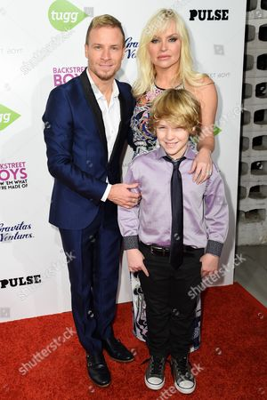 """Brian Littrell, left, Baylee Littrell, foreground, and Leighanne Wallace arrive at the Backstreet Boys: Show â?˜Em What You're Made Of premiere in Los Angeles. Baylee Littrell, 13, is making his Broadway debut in """"Disaster"""