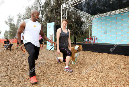 Banfield Pet Hospital® and celebrity trainer Dolvett Quince, from NBC's hit television show 'The Biggest Loser,' hosts a fitness class for dogs and their owners at Barrington Park, on in Los Angeles. In an effort to raise awareness about overweight pets and the importance of healthy activity for pets and their owners, Quince and Banfield partnered together to develop this custom workout plan. To see Quince's canine-friendly workout tips, visit banfield.com/fitness