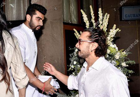 Bollywood actors Aamir Khan and Arjun Kapoor during the prayer meeting in loving memory of Ram Mukherjee
