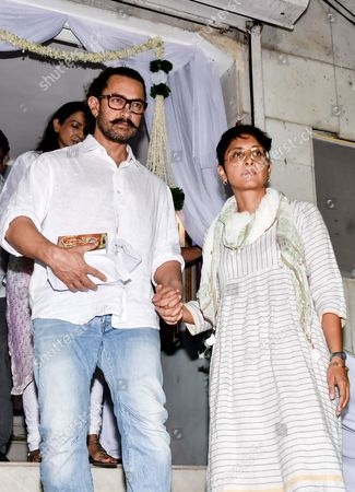 Bollywood actor Aamir Khan with his wife Kiran Rao during the prayer meeting in loving memory of Ram Mukherjee