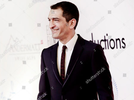 """Egyptian actor Amr Waked arrives on the red carpet during the first International El Gouna Film Festival, in the Red Sea resort of el-Gouna, Egypt. An Egyptian court has convicted actor Amr Waked of """"Salmon Fishing in the Yemen"""" fame for damaging a car parked outside his Cairo home, sentencing him to three months in prison, his lawyer said on Monday, in a case suspected of serving as punishment for the actor's opposition to President Abdel-Fattah el-Sissi's rule"""