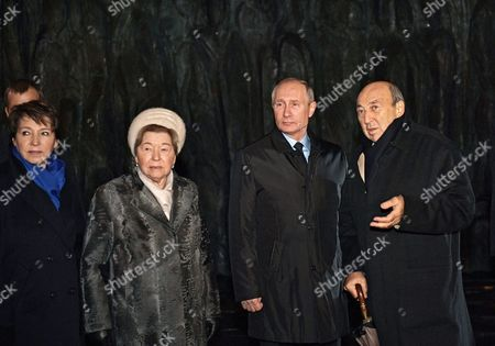 Russian President Vladimir Putin (2-R), sculptor Georgy Frangulyan (R),  daughter of the first Russia's President Boris Yeltsin, Tatyana Yumasheva (L) and Boris Yeltsin's widow Naina Yeltsina (2-L)  attend a ceremony of unveiling the country's first national memorial to victims of Soviet-era political repressions titled 'The Wall of Grief' designed by sculptor Georgy Frangulyan,  in downtown Moscow, Russia, 30 October 2017.
